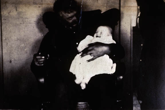 Image of Miner with baby