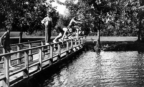 Image of Boys diving off a bridge